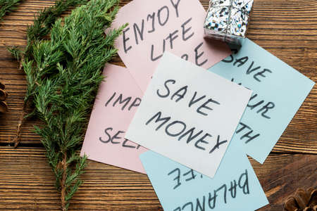 Motivational text, phrases on note papers with fir, spruce branches on wooden background