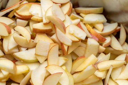 pan, bowl full of sliced apples for jam, marmalade cooking