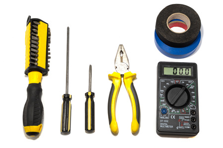 Tools for electrician and multimeter. Фото со стока
