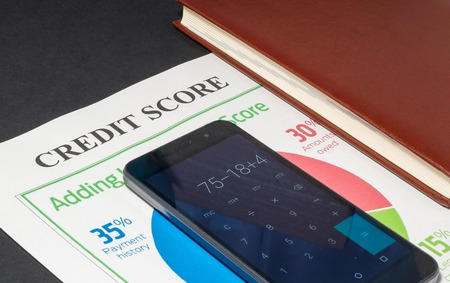 Credit score report with keyboard and notepad.