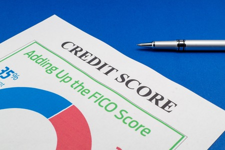 Credit score report with pen on the blue table. 스톡 콘텐츠