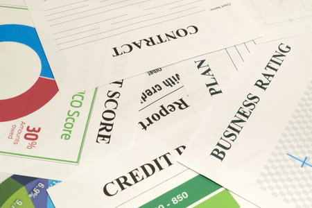 Credit score, report, rating and contract - documents on the table.