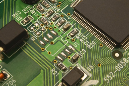 Close up on electronic board in hardware repair shop, blurred and toned image. Banco de Imagens