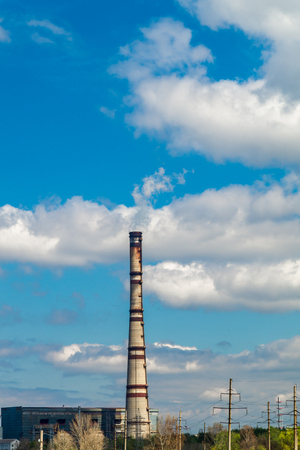 Thermal power station, industrial landscape with big chimney against the blue sky. 版權商用圖片