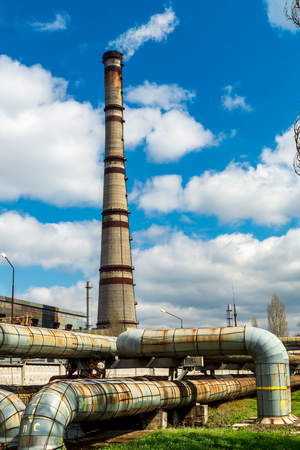 Thermal power station, industrial landscape with big chimneys against the blue sky. Standard-Bild - 121253208