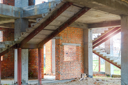 House under construction with red bricks - view inside. Stock Photo