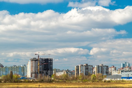 House under construction in the city against the blue sky - panoramic view.