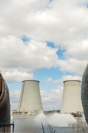 Thermal power station, industrial landscape with big chimneys against the blue sky. Standard-Bild - 121325070