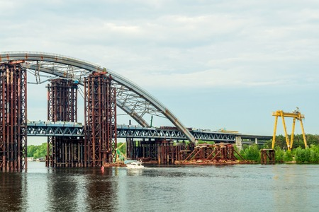 Large bridge under construction across the Dnieper River in Kiev Ukraine. Panoramic view.
