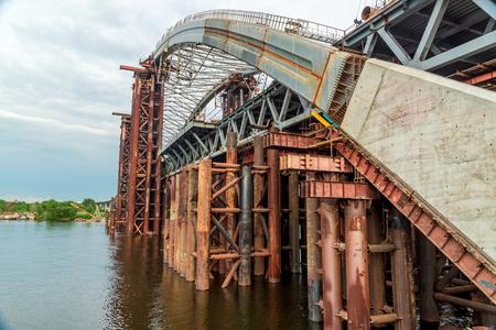 Large bridge under construction across the Dnieper River in Kiev Ukraine. Panoramic view.