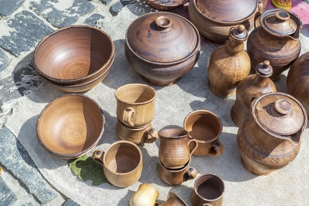 Dishes made of clay, different jugs handmade. Manual work is exhibited for sale.
