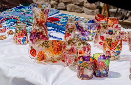 Beautiful color drink glasses on the cloth exposed for sale. Banco de Imagens