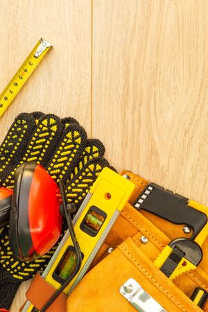 Protective equipment and tools in a bag for the builder on a wooden 写真素材