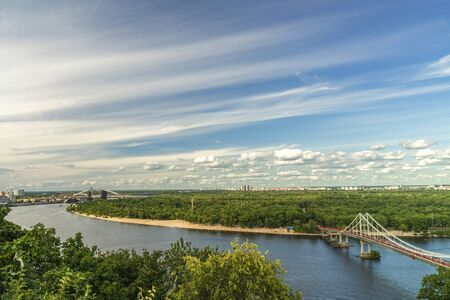Cityscape, view of the Dnieper river and the bridge in Kiev from a height, beautiful panorama.