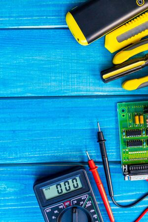 Services for the production of electronics and repair on a wooden blue