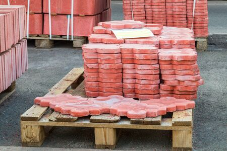 Red tiles piled in pallets, warehouse paving slabs in the factory for its production Stok Fotoğraf