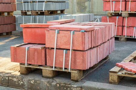 Red tiles piled in pallets warehouse paving slabs the factory for its production