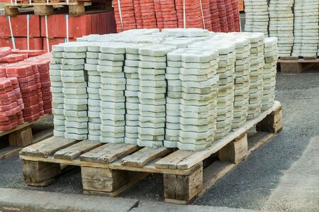 Gray tiles piled in pallets warehouse paving slabs the factory for its production Stok Fotoğraf