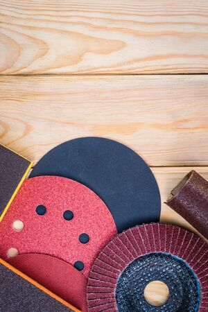 Set of abrasive tools and sandpaper on wooden
