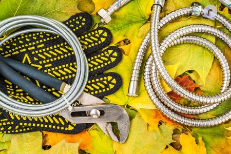 Necessary set tools for plumbers indispensable for master on background of yellow leaves Фото со стока - 131364232