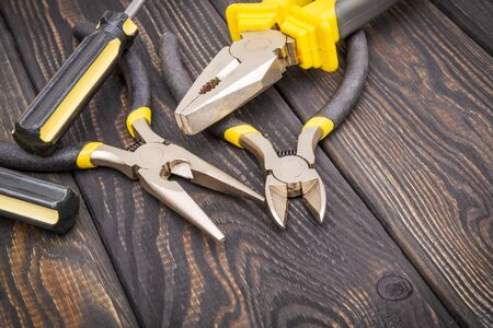 Tools for master builder and accessories set on a wooden black vintage background