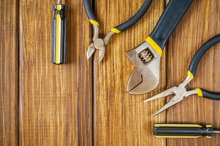 Tools for master builder and accessories set on wooden vintage background for the master Builder Stockfoto