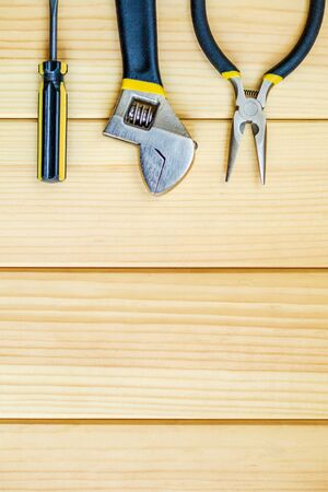 Tools for master builder and accessories set on wooden background for the master Builder