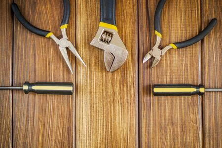 Tools for master builder and accessories set on brown wooden vintage background for the master Builder