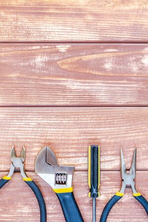 Tools for master builder and accessories set on wooden vintage background for the master Builder 写真素材