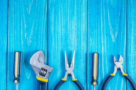 Tools for master builder and accessories set on blue wooden vintage background for the master Builder
