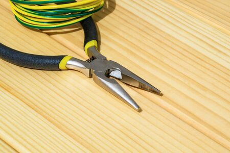 Tool and electric wire for master electrician on wooden boards