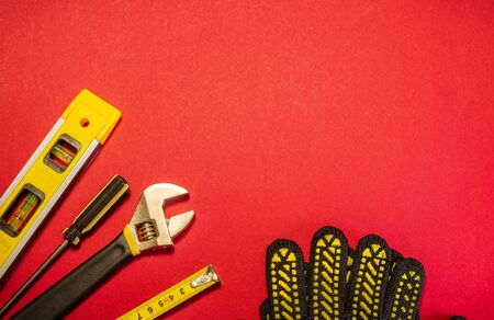 Tools for master builder and accessories set on red background