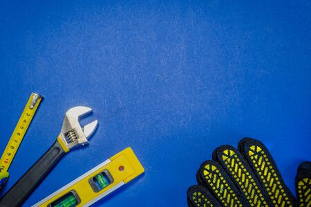 Tools for master builder and accessories set on blue background