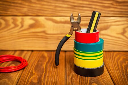 Three insulating tape for electrician on wooden boards Stock Photo