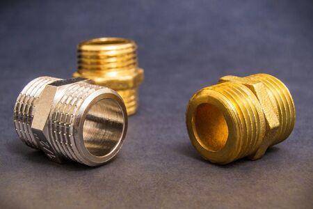 Set of brass fittings is often used for water and gas installations Stock Photo
