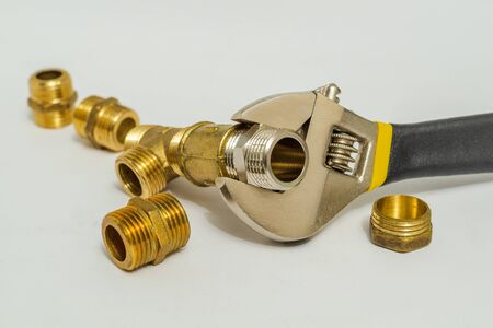Set of fittings and adjustable spanner used to connect for water and gas installations