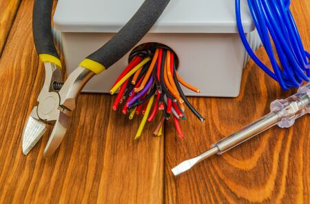 Electrical junction boxs with cables wire and tools usually used in the electric installation process Stock Photo