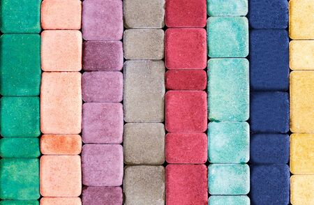 Decorative multi colored tile for the sidewalk from natural stone of various shapes Stock Photo