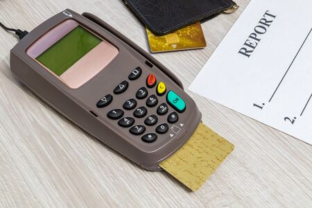 Payment terminal with card for receiving money on table top view