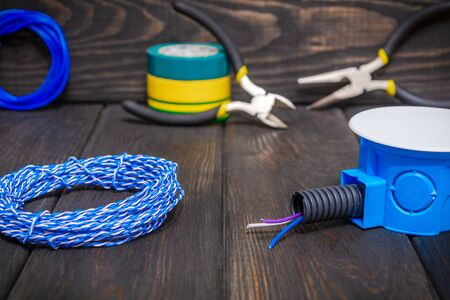 Electrical junction blue box with wires usually used in the electric installation process Reklamní fotografie