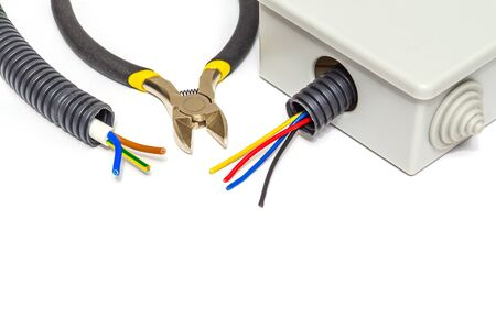 Electrical junction gray box with wires usually used in electric installation process on white isolated background