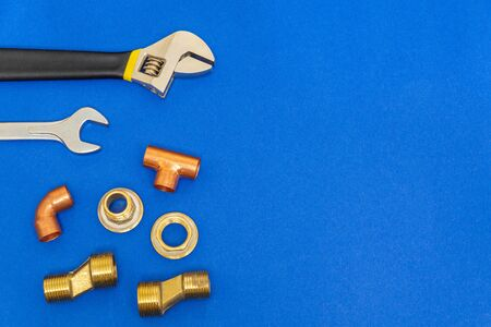 Necessary set of tools for plumbing isolated on blue background with space for advertising 版權商用圖片