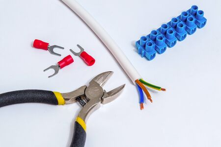 Spare parts, tool and wires for replacement or repair of electrical equipment on gray background