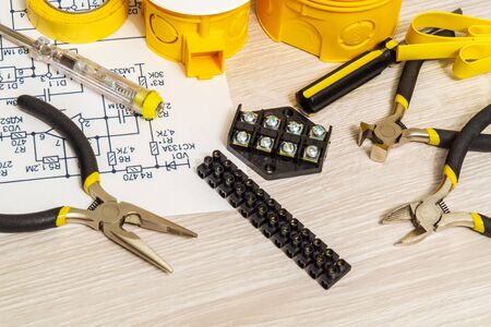 Kit spare parts and tools for electrical prepared before repair or setting on light wooden surface