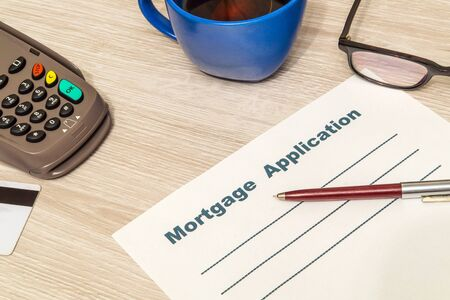 Mortgage agreement form blank is prepared for filling on table in an office