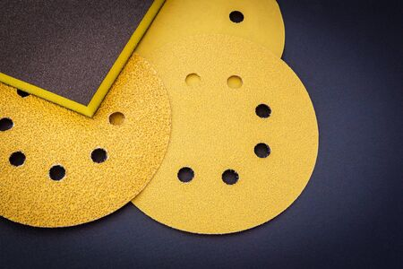 Set of yellow abrasive tools on black background. The wizard is used for grinding items