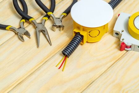 Kit spare parts and tools for electrical prepared before repair on wooden boards Zdjęcie Seryjne