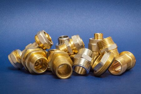 Many brass fittings is often used to connect for water and gas installations on a blue background