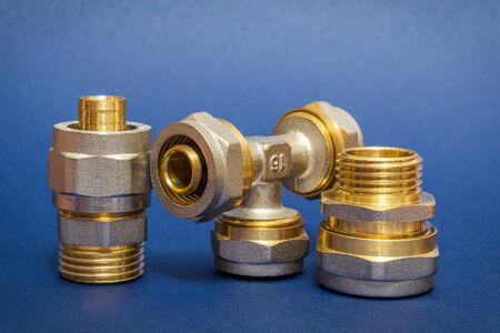 Three brass fittings is often used to connect for water and gas installations on a blue background