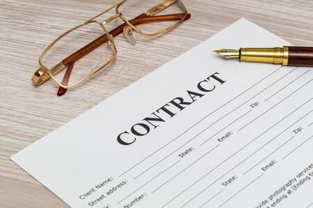 Contract form on the office desk with glasses and pen, business idea